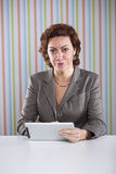 Businesswoman using a digital tablet Royalty Free Stock Image