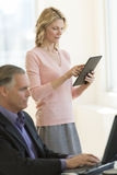 Businesswoman Using Digital Tablet In Office Royalty Free Stock Photos