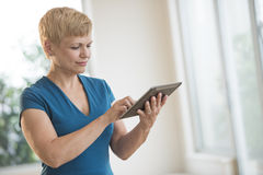 Businesswoman Using Digital Tablet In Office Stock Photography
