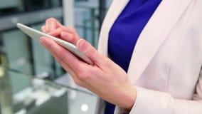Businesswoman using digital tablet in office stock video