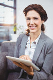 Businesswoman using digital tablet in office Stock Image