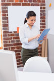 Businesswoman using digital tablet in office Stock Photo