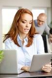 Businesswoman using digital tablet Stock Photo