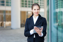 Businesswoman using a digital tablet stock image