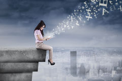 Businesswoman using digital tablet on the rooftop Royalty Free Stock Photo
