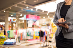 Businesswoman using digital tablet in the shopping mall. Royalty Free Stock Photo