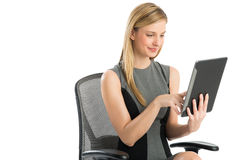 Businesswoman Using Digital Tablet While Sitting On Chair Royalty Free Stock Photo
