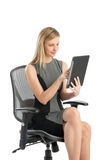 Businesswoman Using Digital Tablet While Sitting On Office Chair Stock Image