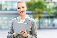 Businesswoman using digital tablet Stock Images