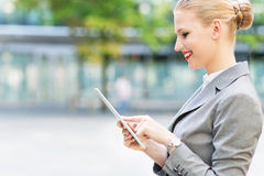 Businesswoman using digital tablet Stock Image