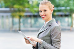 Businesswoman using digital tablet Royalty Free Stock Images