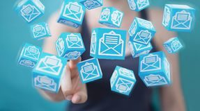 Businesswoman using floating cube emails 3D rendering. Businesswoman on blurred background using floating cube emails 3D rendering Stock Photo