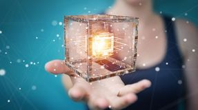 Businesswoman using futuristic cube textured object 3D rendering. Businesswoman on blurred background using futuristic cube textured object 3D rendering Royalty Free Stock Images