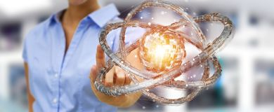 Businesswoman using futuristic torus textured object 3D renderin. Businesswoman on blurred background using futuristic torus textured object 3D rendering Royalty Free Stock Photography