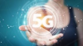 Businesswoman using 5G network interface 3D rendering. Businesswoman on blurred background using 5G network interface 3D rendering Royalty Free Stock Photos