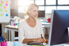 Businesswoman using graphic tablet Royalty Free Stock Photography