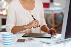 Businesswoman using graphic tablet Royalty Free Stock Image
