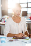 Businesswoman using graphic tablet Royalty Free Stock Photo