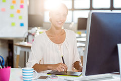 Businesswoman using graphic tablet Stock Photos