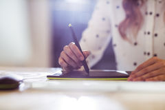 Businesswoman using graphics tablet in office Royalty Free Stock Photos