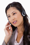 Businesswoman using headset Stock Images