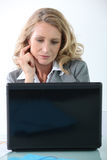 Businesswoman using her laptop Stock Images
