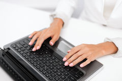Businesswoman using her laptop computer Stock Photo