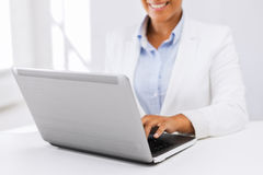 Businesswoman using her laptop computer Stock Photography