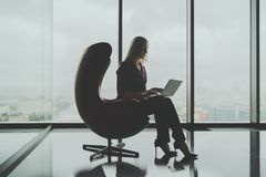 Businesswoman using her laptop in luxury office royalty free stock photos