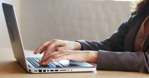 Businesswoman using her laptop at work stock footage