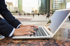 Businesswoman using her laptop in working environment, building Stock Photography