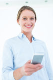 Businesswoman using her mobile phone Royalty Free Stock Images