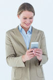 Businesswoman using her mobile phone Stock Images