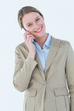 Businesswoman using her mobile phone Royalty Free Stock Photography