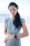 A businesswoman using her smartwatch Stock Photos