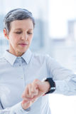 A businesswoman using her smartwatch Royalty Free Stock Image