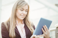 Businesswoman using her tablet pc Stock Image