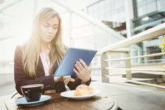Businesswoman using her tablet pc Stock Photography