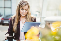 Businesswoman using her tablet pc Stock Photo