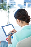 Businesswoman using her tablet pc Royalty Free Stock Photography