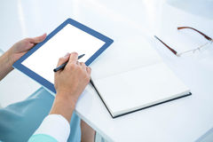 Businesswoman using her tablet pc Royalty Free Stock Photo