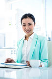 Businesswoman using her tablet pc Royalty Free Stock Photos