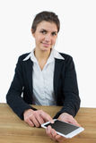 Businesswoman using her tablet pc Royalty Free Stock Image