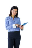 Businesswoman using her tablet pc Stock Images