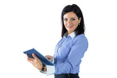 Businesswoman using her tablet pc Stock Photos