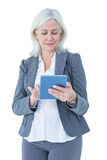 Businesswoman using her tablet Stock Image