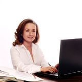 Businesswoman using a laptop. And smiling Stock Photography