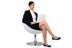 Businesswoman using a laptop Royalty Free Stock Photo