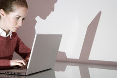 A businesswoman using a laptop Stock Photos