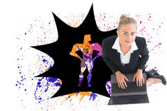 Businesswoman using laptop Stock Image